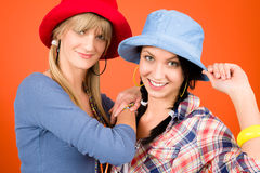 Two young friends woman funny outfit. Two women friends young wear funny hats smiling crazy outfit Stock Photography