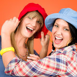 Two young friends woman funny outfit. Two women friends young wear funny hats smiling crazy outfit Royalty Free Stock Photo