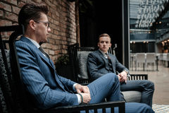 Two young gentleman having conversation Royalty Free Stock Photography