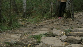 Two young girl athletes to run in forest on rocks. Zlatoust, Russia - August 28, 2016: two young girl athletes to run in forest on rocks during Mountain marathon stock footage