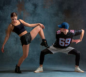 The two young girl and boy dancing hip hop in the studio stock photo