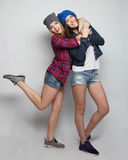 Two young girl friends having fun together. Stock Images