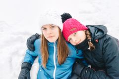 Two young girl friends outdoors in winter royalty free stock photos