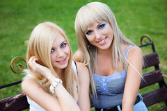 Two young girl friends in a park Stock Photo