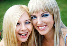 Two young girl friends in a park Stock Photos