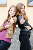 Two young girl friends showing okay Royalty Free Stock Image