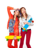 Two young girl friends standing having fun together Stock Photos