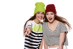 Two young girl friends standing having fun together. Royalty Free Stock Photography