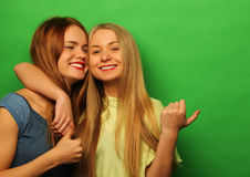 Two young girl friends standing together and having fun. Stock Photo