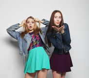 Two young girl friends standing together Stock Images