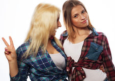 Two young girl friends standing together and having fun Royalty Free Stock Photography