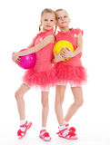 Two young girl gymnast with sports balls. Isolated on white background royalty free stock photos