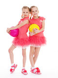 Two young girl gymnast with sports balls. Stock Images