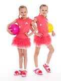 Two young girl gymnast with sports balls. Royalty Free Stock Photo