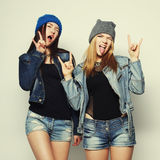Two young girl hipster friends standing together Stock Image
