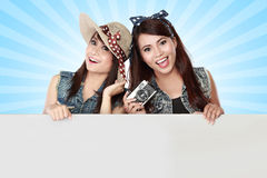 Two young girl holding blank white board Stock Photos