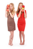 Two young girl holds an three apples Stock Photography