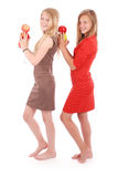 Two young girl holds an three apples Stock Image