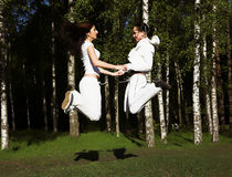 Two young girl jump in park Royalty Free Stock Photo