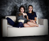 Two young girl looks TV Stock Image
