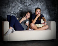 Two young girl looks TV Royalty Free Stock Photo