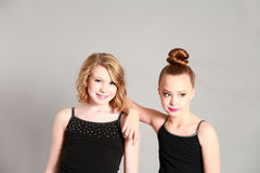 Two young girl models. Fashion shot of two young girls Royalty Free Stock Image