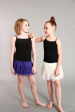 Two young girl models. Full length fashion shot of two young dancer girls Stock Photos