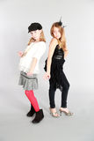 Two young girl models. Full length fashion shot of two young girls Royalty Free Stock Image