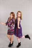 Two young girl models. Full length fashion shot of two young girls Royalty Free Stock Photo