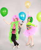 Two young girl models. Full length fashion shot of two young girls with ballooms Royalty Free Stock Photo