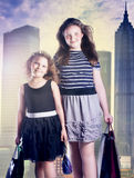 Two young girl posing with bags. Stock Photo