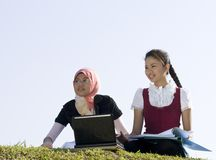 Two young girl studying together Stock Photo