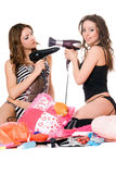 Two young girlfriends with hair dryers Stock Photo