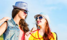 Two young girlfriends having fun Stock Images