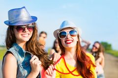 Two young girlfriends having fun Royalty Free Stock Image