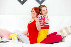 Two young girlfriends showing thumbs up gesture Royalty Free Stock Photography