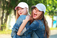 Two young girlfriends stock image