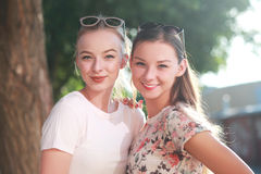Two young girlfriends royalty free stock photos