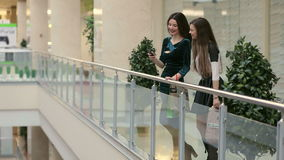 Two young girlfriends walking through the Mall. stock video footage