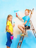 Two young girls against the background of wall Royalty Free Stock Photo