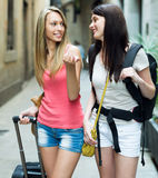 Two young girls with baggage heading to hotel Royalty Free Stock Photo