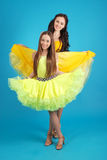 Two young girls in ballroom dress Royalty Free Stock Image