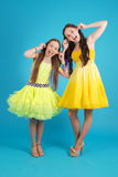 Two young girls in ballroom dress Royalty Free Stock Images