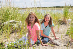 Two young girls at the beach Stock Images
