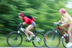 Two  young girls on bicycle Royalty Free Stock Images