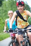 Two  young girls on bicycle Royalty Free Stock Photos
