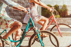 The two young girls with bicycles in park. In summer royalty free stock photography