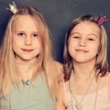 Two young girls at birthday party. On background Stock Photo