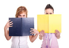 Two young girls with books Royalty Free Stock Photos