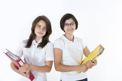 Two young girls with books Royalty Free Stock Images